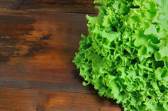 Fresh green salad on wooden background Stock Photo