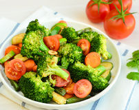 Fresh green salad. With zucchini,cherry tomatoes,carrots,asparagus,broccolli in salt and vinegar dressing Royalty Free Stock Images