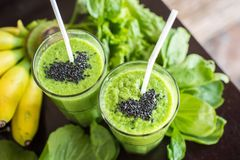 Fresh green smoothie with banana and spinach with heart of sesam Royalty Free Stock Photo
