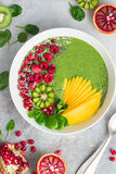 Fresh green smoothie bowl with fruits and berries Royalty Free Stock Photo