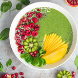 Fresh green smoothie bowl with fruits and berries Stock Photo