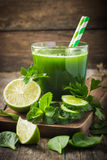 Fresh green smoothie with ingredients Stock Photos
