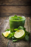 Fresh green smoothie with ingredients Stock Image