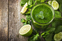 Fresh green smoothie with ingredients Royalty Free Stock Images