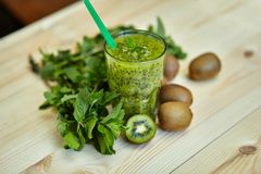 Fresh green smoothie with kiwi and mint . Love for a healthy raw food concept. Healthy eating. Fruit Smoothies Stock Image
