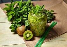 Fresh green smoothie with kiwi and mint . Love for a healthy raw food concept. Healthy eating. Fruit Smoothies Royalty Free Stock Photos
