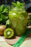 Fresh green smoothie with kiwi and mint . Love for a healthy raw food concept. Healthy eating. Fruit Smoothies Stock Photo