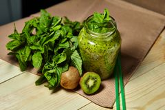 Fresh green smoothie with kiwi and mint . Love for a healthy raw food concept. Healthy eating. Fruit Smoothies Royalty Free Stock Photography