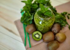 Fresh green smoothie with kiwi and mint . Love for a healthy raw food concept. Healthy eating. Fruit Smoothies Royalty Free Stock Photo