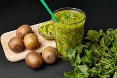 Fresh green smoothie with kiwi and mint . Love for a healthy raw food concept. Healthy eating. Fruit Smoothies. Kiwi Royalty Free Stock Photos