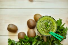 Fresh green smoothie with kiwi and mint . Love for a healthy raw food concept. Healthy eating. Fruit Smoothies. Kiwi Stock Images
