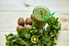Fresh green smoothie with kiwi and mint . Love for a healthy raw food concept. Healthy eating. Fruit Smoothies. Kiwi Stock Image