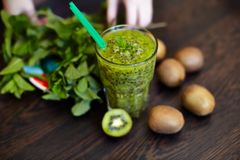 Fresh green smoothie with kiwi and mint . Love for a healthy raw food concept. Healthy eating. Fruit Smoothies. Kiwi Royalty Free Stock Photo