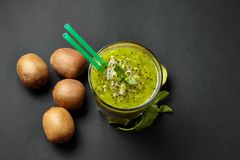 Fresh green smoothie with kiwi and mint . Love for a healthy raw food concept. Healthy eating. Fruit Smoothies. Kiwi Stock Photo