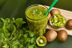 Fresh green smoothie with kiwi and mint . Love for a healthy raw food concept. Healthy eating. Fruit Smoothies. Kiwi Royalty Free Stock Photography