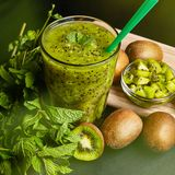 Fresh green smoothie with kiwi and mint . Love for a healthy raw food concept. Healthy eating. Fruit Smoothies. Kiwi Royalty Free Stock Image