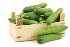Fresh green snack cucumbers in a wooden box Stock Photo
