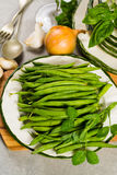 Fresh green snap beans on the plate ready to cook Royalty Free Stock Images