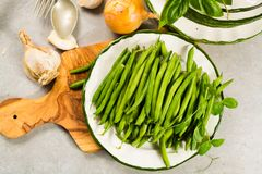 Fresh green snap beans on the plate ready to cook Royalty Free Stock Image