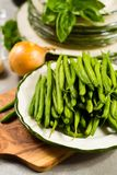 Fresh green snap beans on the plate ready to cook Stock Images