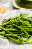 Fresh green snap beans on the plate ready to cook Stock Photo