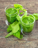 Fresh green spinach leaves smoothie. Healthy food concept Stock Images