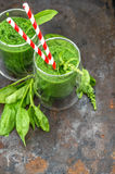 Fresh green spinach leaves smoothie. Healthy food concept Stock Image