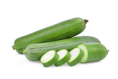 Fresh green sponge gourd or luffa with slice isolated on white. Background Stock Photo