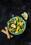 Fresh green spring salad with arugula, yellow pepper and zucchini. Fresh green spring salad with arugula (rucola), yellow pepper, zucchini, sunflower seeds and stock photos