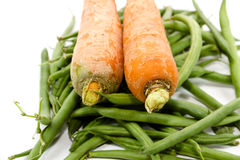 Fresh Green Stick beans with Carrots Royalty Free Stock Images