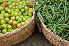 Fresh Green String Beans and Sour Drupe. Baskets of Organic Fresh Green String Beans and Sour Drupes in a traditional bazaar in Iran Royalty Free Stock Images