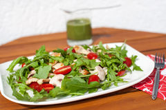 Fresh green salad with rucola tomatoes and grilled chicken Stock Photos