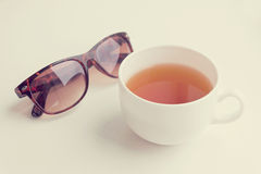 Fresh green tea and sunglasses with retro filter effect Royalty Free Stock Images