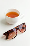 Fresh green tea and sunglasses Stock Images