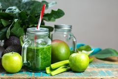 Fresh green vegetables and fruits, ingredients for dietary healthy green detox smoothie or salad royalty free stock images