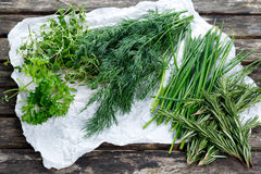 Fresh Green Vegetables Herbs. Dill, Rosemary, Parsley, Chives and thyme. On old wooden table Stock Photo