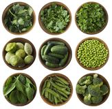 Fresh green vegetables and herbs isolated on a white background. Stock Photos