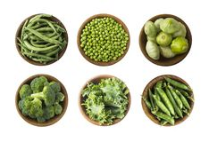 Free Fresh Green Vegetables Isolated On A White Background. Squash, Green Peas, Broccoli, Kale Leaves And Green Bean In Wooden Bowl. Ve Stock Image - 151891341