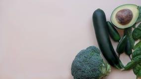 Fresh green vegetables on light table. Healthy food stock photos