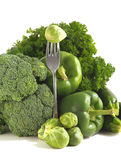 Fresh green vegetables on a white background. Royalty Free Stock Photo