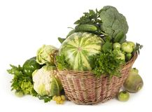 Green vegetables in wicker basket Royalty Free Stock Images