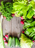 Fresh green vegetables on a wooden board, vegan, place for text Stock Photography