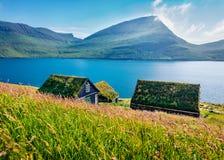 Fresh green view of Bour village. Splendid morning scene of typical turf-top houses on Vagar island, Faroe, Kingdom of Denmark, E
