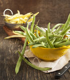 Fresh Green and Yellow Beans. On wooden table Royalty Free Stock Photo