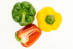 Fresh green, yellow and cut half red bell peppers Stock Photography