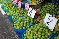 Fresh green and yellow limes at the market Stock Image