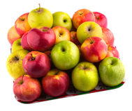 Fresh green, yellow and red apples on a tray. Isolated on white background royalty free stock photography