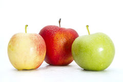 Fresh Green, Yellow and Red Apples  on White Stock Images