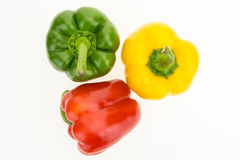 Fresh green, yellow and red bell peppers, top view Stock Photo