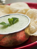 Fresh Green Yoghurt Chutney with mini Papadoms Royalty Free Stock Image